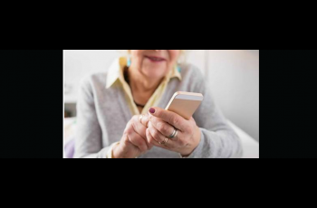Close up of older woman's hands holding a smart phone