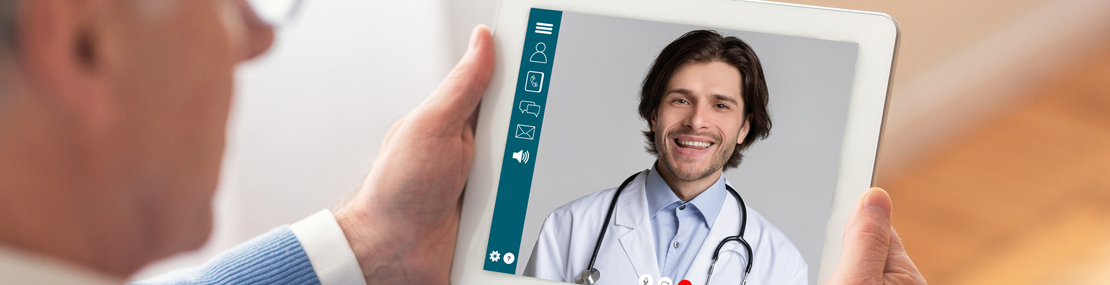 older man looking at a doctor on an iPad screen