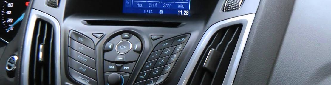 Driver playing with the Radio while driving