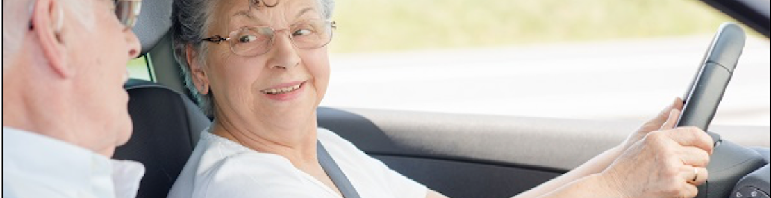 Older woman driving with her husband