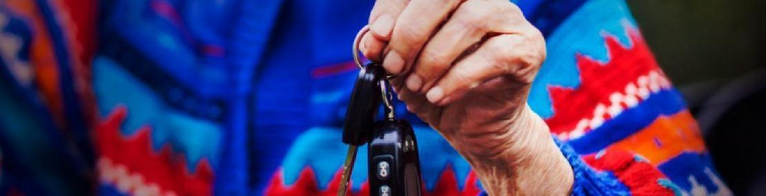 Older woman holding keys.