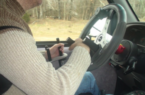 Older driver uses modified steering wheel for easier vehicle control