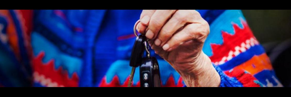 Older woman holding keys.